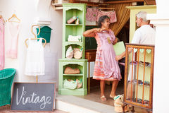 Mature Couple Shopping In Vintage Clothing Store stock images
