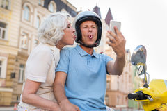 Mature couple showing tongues. Royalty Free Stock Image