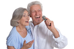 Mature couple singing songs Stock Photos