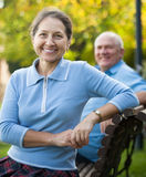 Mature couple sitting on   bench Royalty Free Stock Photography