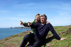 A mature couple sitting on the coastal path Stock Image