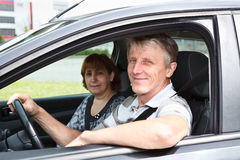 Mature couple sitting in domestic car Royalty Free Stock Photography
