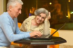 Mature couple sitting Stock Images