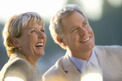 Mature couple sitting at outdoor restaurant table, smiling, close-up Royalty Free Stock Image
