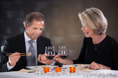 Mature Couple Sitting In A Restaurant Stock Photo