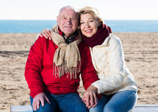 Mature couple sitting by sea Royalty Free Stock Photo