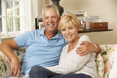 Mature Couple Sitting On Sofa At Home Together Stock Photos