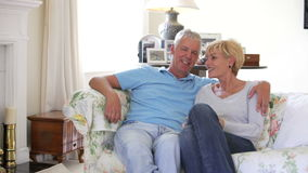 Mature Couple Sitting On Sofa At Home Together stock video