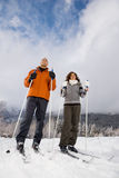 A mature couple skiing royalty free stock photography
