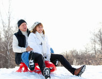 Mature couple sledding Royalty Free Stock Photography