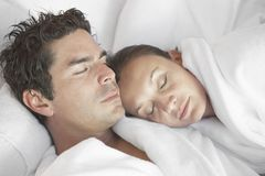 Mature Couple Sleeping Stock Photo