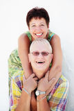 Mature couple smiling and embracing Stock Photos