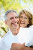 Mature couple smiling and embracing. Lifestyle portrait of a mature couple smiling and embracing Stock Photo
