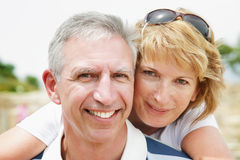 Mature couple smiling and embracing. Lifestyle portrait of a mature couple smiling and embracing Royalty Free Stock Images