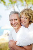 Mature couple smiling and embracing. Lifestyle portrait of a mature couple smiling and embracing Royalty Free Stock Photos