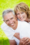 Mature couple smiling and embracing. Lifestyle portrait of a mature couple smiling and embracing Stock Photos