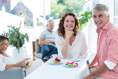 Mature couple smiling while sitting in restaurant Royalty Free Stock Photos