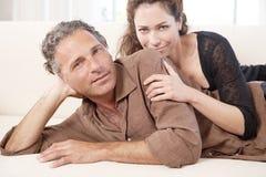 Mature couple on sofa. Stock Image