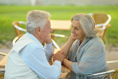 Mature couple in spring park Stock Photos