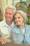 Mature couple in spring park Royalty Free Stock Photos