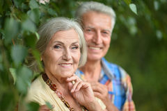 Mature couple in spring park Royalty Free Stock Images
