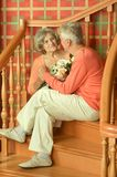 Mature couple on stairs with railing Royalty Free Stock Photo