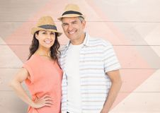 Mature couple standing and smiling Stock Photos