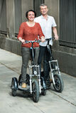 Mature couple staying with electric bikes Royalty Free Stock Images