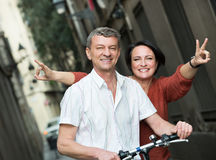 Mature couple staying with electric bikes Royalty Free Stock Image