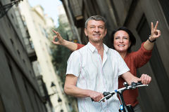 Mature couple staying with electric bikes stock images