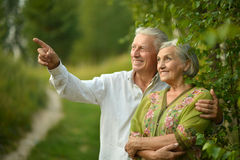 Mature couple on  in summer park Royalty Free Stock Photo