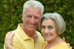 Mature couple on  in summer park Stock Photos