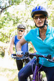 Mature couple with sunglasses riding bike Royalty Free Stock Photo
