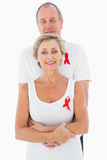 Mature couple supporting aids awareness together Royalty Free Stock Images