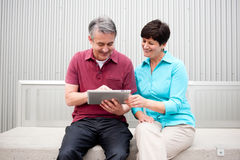 Mature couple with tablet Stock Photo
