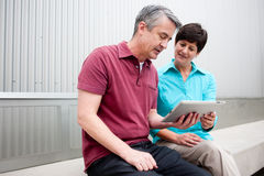 Mature couple with tablet Royalty Free Stock Photography