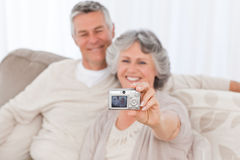 Mature couple taking a photo of themselves Stock Image