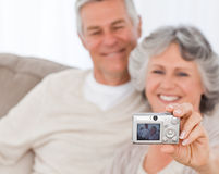 Mature couple taking a photo of themselves Stock Images