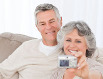 Mature couple taking a photo of themselves Royalty Free Stock Photo