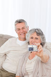 Mature couple taking a photo of themselves at home Royalty Free Stock Image