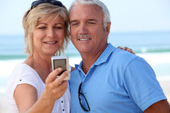 Mature couple taking a picture Stock Image