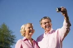 Mature couple taking picture. royalty free stock photos