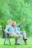 Mature couple taking selfie with cell phone in park Royalty Free Stock Image