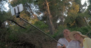 Mature Couple Taking Selfie with Monopod Stick stock footage