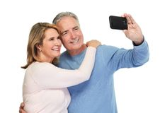 Mature couple taking selfie. Royalty Free Stock Images