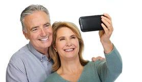 Mature couple taking selfie. Royalty Free Stock Image