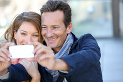 Mature couple taking selfie in town Royalty Free Stock Photo