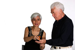 Mature couple taking their drugs Royalty Free Stock Images