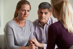 Mature Couple Talking With Counsellor. Mature Couple Talk With Counsellor royalty free stock photo