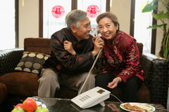 Mature couple talking on the phone Stock Images